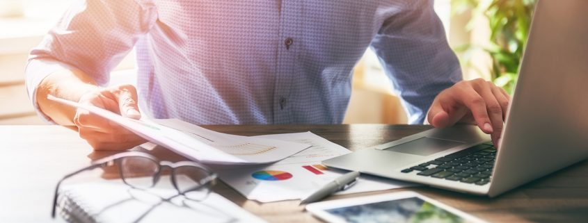 Investor Working on Computer at Desk
