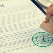 Loan Contract Being Signed Stamped and Approved
