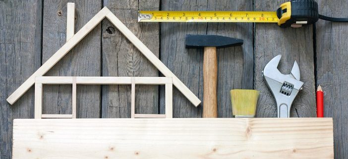 Home Construction Design on Flat Surface with Tools and Tape Measurer