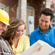 California Home Builder Reviewing Construction Plans with Clients